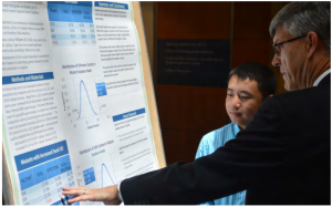 Yia presents his poster on NIR to an audience
